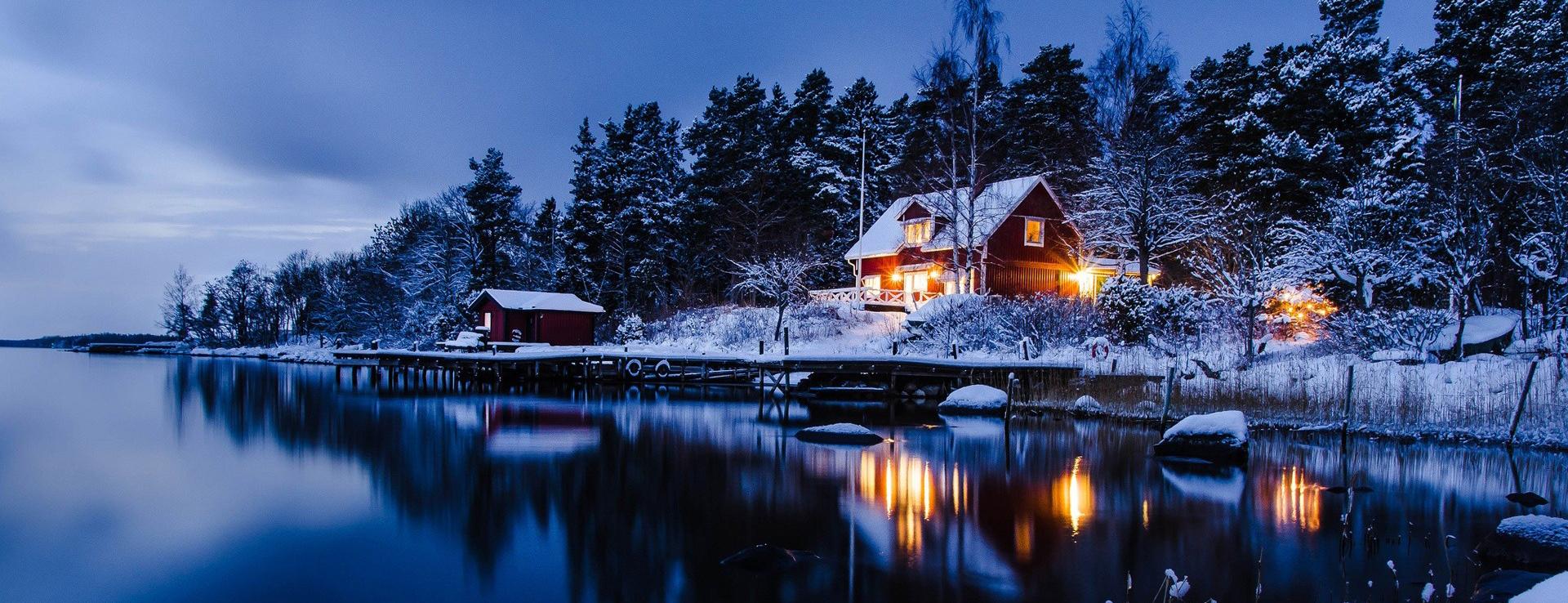 forest-houses-lights-snow-sweden-winter